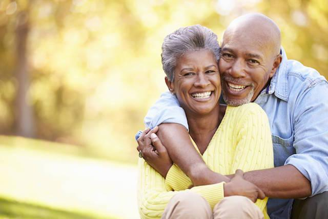 Happy Older Couple Smiling in Park | Dentistry in Elgin IL