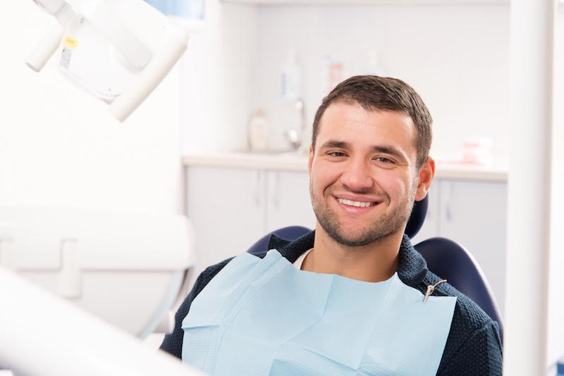 Man Smiling in Dental Chair | Elgin IL Dentist