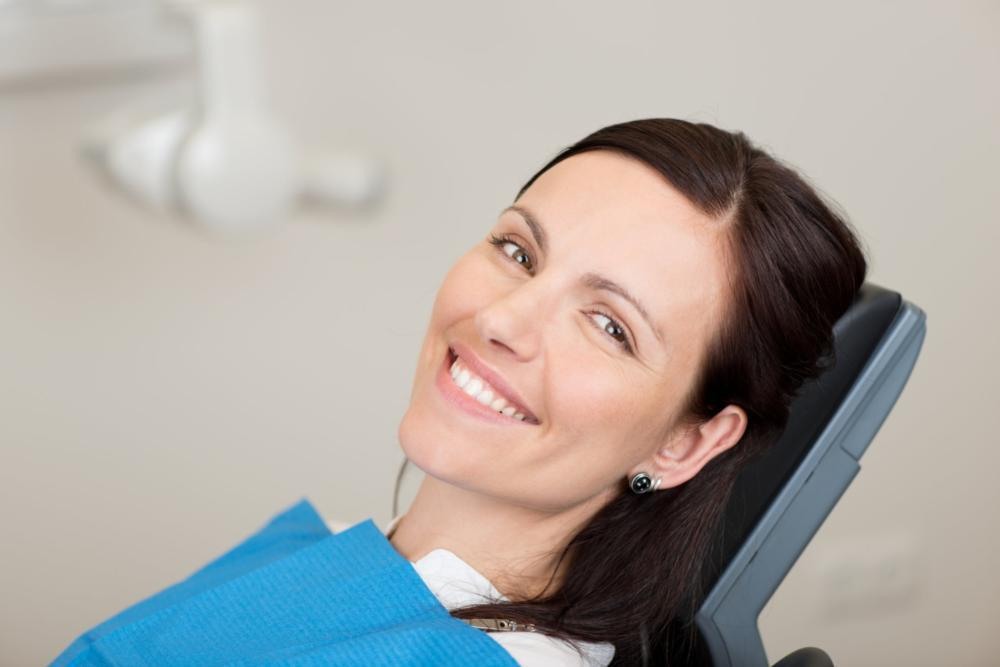 Woman sitting in dental chair smiling | Dentist Elgin IL